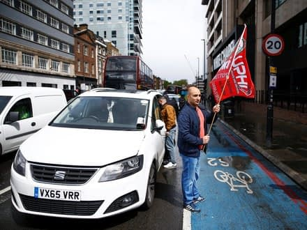 Ride-hail drivers protesting outside the Uber office in London on Wednesday.